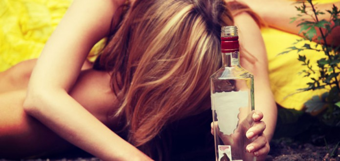 Girl Holding Bottle of Vodka